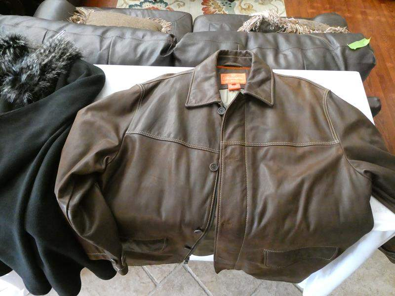Lot # 157- Women's clothing- Includes Façonnable leather jacket! (main image)