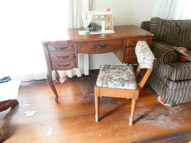 Lot # 201- Vintage Singer sewing machine- see all pictures, comes with some sewing supplies as well.  desk with vintage chair (main image)