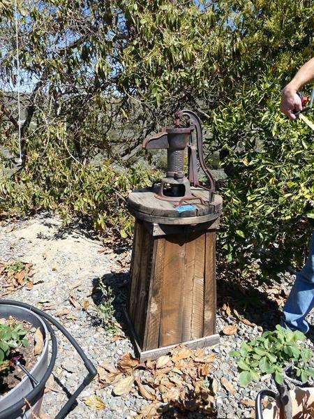 Lot # 84- Cool, antique water pump (main image)
