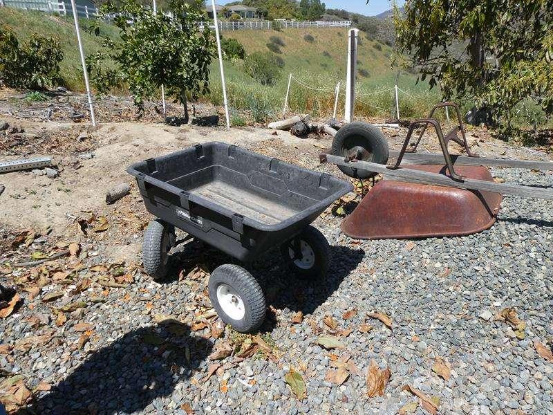 Lot # 90- Wheelbarrow + Gorilla cart (main image)