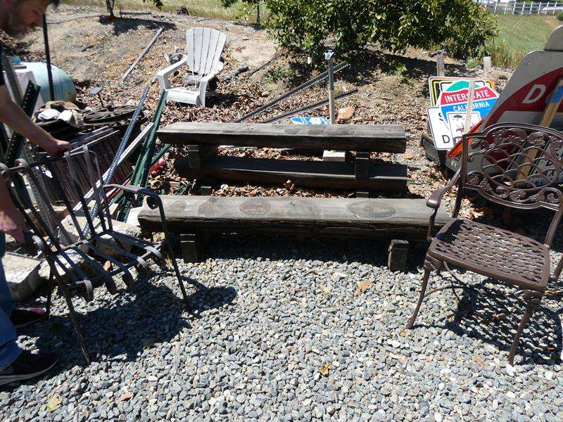 Lot # 94- Outdoor stump benches and chairs (main image)