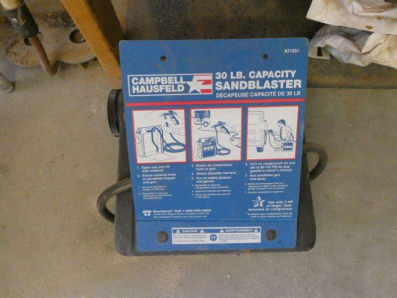 Lot # 117- Campbell Hausfeld sandblaster, vintage wood pulley, wood pieces, puzzles + more! (main image)