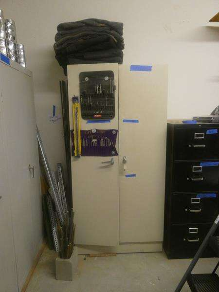 Lot # 175- Storage cabinet and packing blankets (main image)