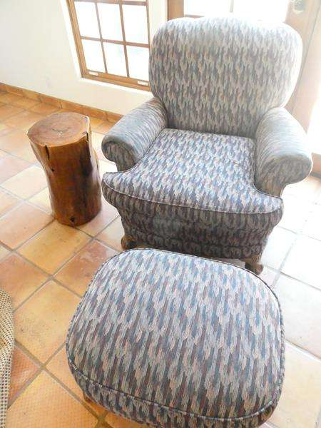 Lot # 24-Vintage fabric chair with Matching Ottoman and Handcrafted Glazed Avocado Tree stump Table (main image)