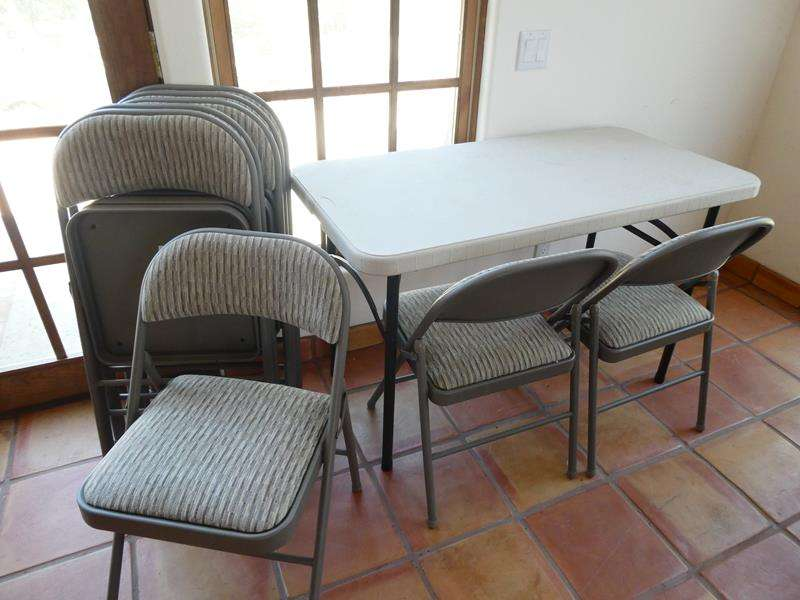 Lot # 27- Party Essentials! Portable Table with 8 Folding Chairs! (main image)