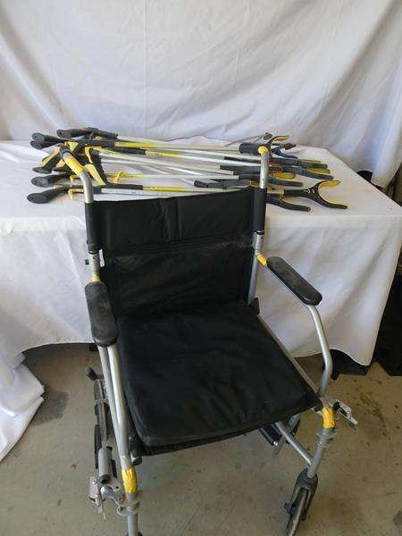 Lot # 196- Wheel chair and multiple hand grabbers (main image)