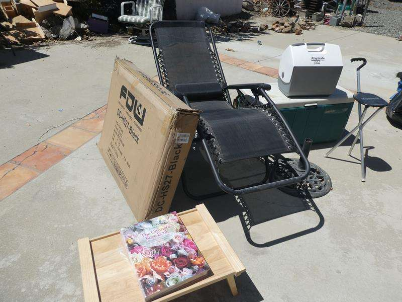 Lot # 198- Outdoor jackpot. 2 lounge chairs (1 new in box), 2 coolers, umbrella stand, t.v. tray with new rose book  (main image)