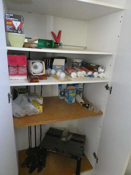 Lot # 204- Black and Decker Jigsaw table along with contents of the cupboard! (main image)