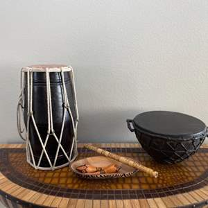 Lot # 9- Music Lovers Lot; 2 drums, flute, wooden shakers, wooden bowl and Beatles rug