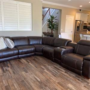 Lot # 17-Sectional couch with built in speakers, 2 pillows and 2 throws- *see all pictures for details