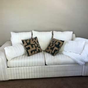 Lot # 70- Sofa sleeper with extra throw pillows