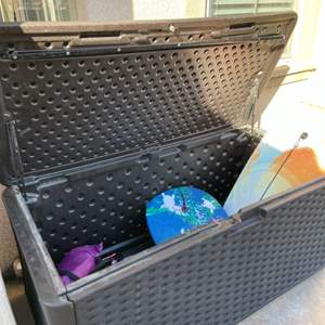 Lot # 49- Suncast Patio Plastic Weave Storage Box and Blow up Couch