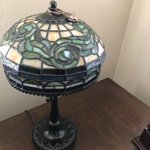 Lot # 78- Beautiful stain glass lamp along with table and clock