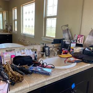 Lot # 100- Beauty station; curling irons, press on nails and more!