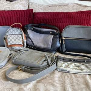 Lot # 102- Handbags, Purses, and Clutches by Simply Vera, Dasein & more