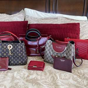 Lot # 103- Kate Spade coin wallet, and other classy handbags, purses & wallets