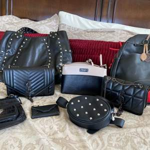 Lot # 106- Kate Spade Purse and more stylish purses to choose from