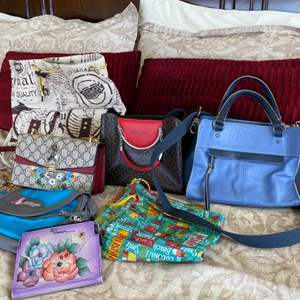 """Lot # 108- """"the sak""""  purse along with other purses"""