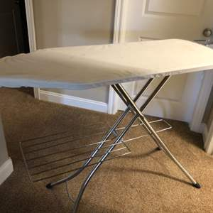Lot # 121- Ironing board and laundry supplies