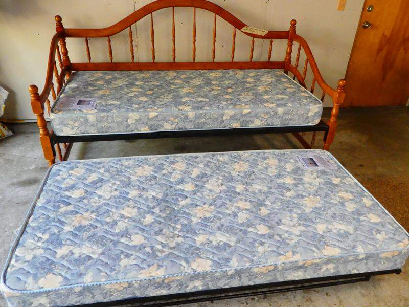 Lot # 13- Solid wood day bed with trundle and mattress. (frame is metal) (main image)