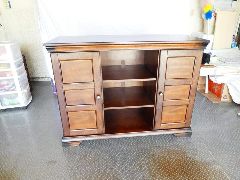 Lot # 12- Solid wood, sturdy entertainment/ TV stand (main image)