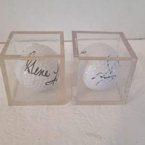 2 Signed Golf Balls in Display