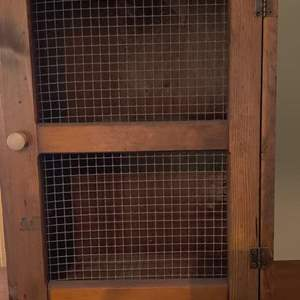 Lot # 16 country cabinet with chicken wire like a pie safe 16 and 1/2 by 24