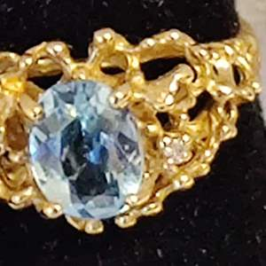 Lot # 37 size 6 14 karat gold ladies nugget ring with a blue topaz 3.5