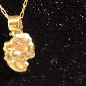 Lot # 39 14 kt gold necklace with 10 karat gold nugget pendant 2.6 g total weight change 19 in Long