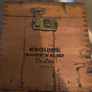 Lot # 66 wooden shoe shine box and contents