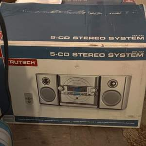 Lot # 73 brand new  in the box Tru-Tech AM FM stereo system 5 CD