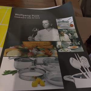 Lot # 75 new in the box Wolfgang Puck 18-piece cookware set