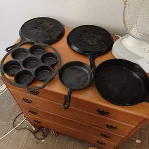 Lot # 89 lot of 10 pieces of cast iron frying pans and more cornbread