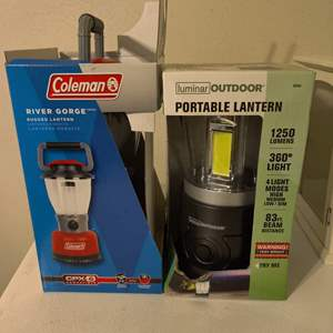 Lot # 95 two new lanterns in the box Coleman and luminar
