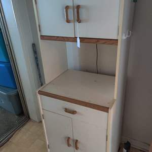 Lot # 98 White and wood trim microwave cart with top on it doors and drawers