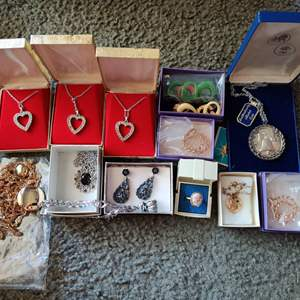 Lot # 128 red bag full of costume jewelry in Little boxes