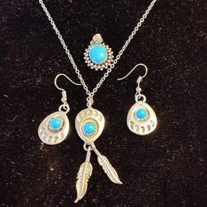 Lot # 142 native American style Sterling and turquoise necklace and pendant and earring set with an extra pendant