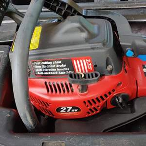 Lot # 165 homelite chainsaw in the case great condition untested