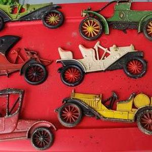 Lot # 174 6 metal cars that hang on the wall three made by Sexton and three by Midwest