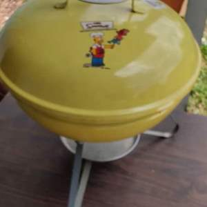 Lot # 188 very unusual Weber grill with the Simpsons on it unused does have a little rust