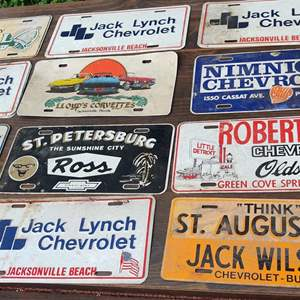 Lot # 226 12 metal dealers tags Jacksonville St Augustine Green cove springs florida except for one it is composition