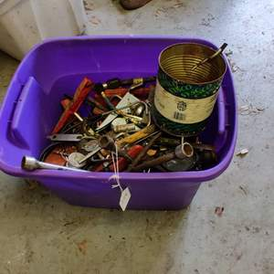 Lot # 248 purple been full of miscellaneous tools and shop items
