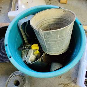 Lot # 262 round blue bin full of miscellaneous tools and garage items