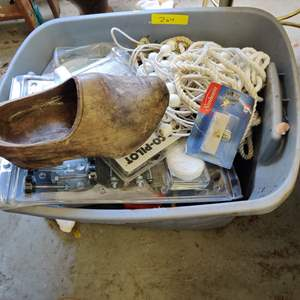 Lot # 264 gray bin with miscellaneous tools garage items and wooden shoes