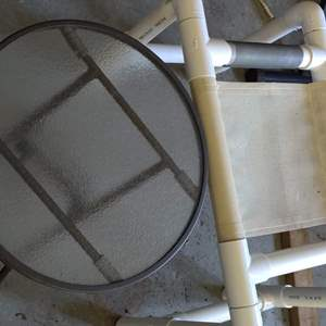 Lot # 322 PVC stool in a glass metal folding outside table