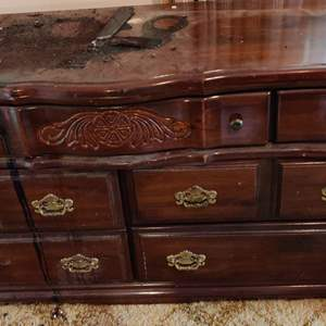 Lot # 355 solid pine american-made dresser as is drawers all work fine but the top looks like it's got tar on it