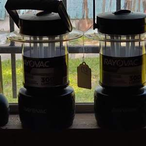 Lot # 371 two lanterns one is Ray vac and a flashlight