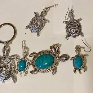 Lot # 379 turtle pendant and two pair of turtle earrings and a turtle keychain very nice