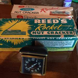 Lot # 387 a lot of to Reed's nutcrackers in the box and a travel alarm clock