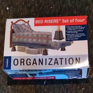 Lot # 388 set of 4 bed risers in the box new